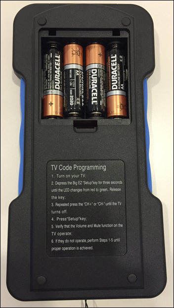 The back of the large-button remote displays with the battery case open and four AA batteries inside. Instructions for TV Code Programming can be found under the Program the Large-Button Remote to Control Your TV section.