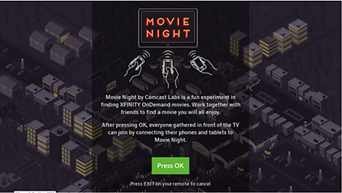The opening page of the Movie Night App for X1 appears, with the option to press OK to begin.