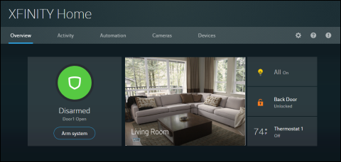 XFINITY Home Portal displays arming status on the left, Arm System button appears below the green Disarmed circle.