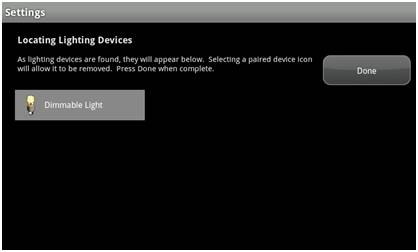 "XFINITY Home Touch Screen Controller, Settings screen reading ""Locating Lighting Devices"" and finding the ""Dimmable Light"""